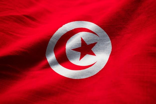 Gros plan du drapeau de la tunisie ébouriffé, drapeau de la tunisie soufflant dans le vent