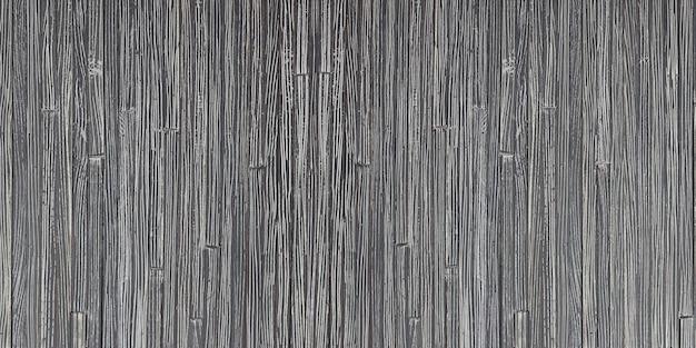 Gros plan du mur de bambou noir, belle surface de texture en rotin pour le fond