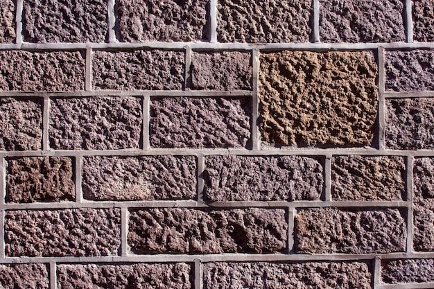 Gros plan du mur de pierre d'un bâtiment historique
