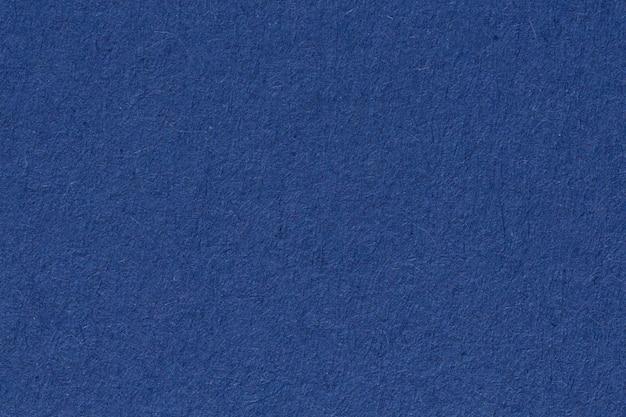 Gros plan du papier bleu, texture. fond. photo haute résolution. salut res photo.