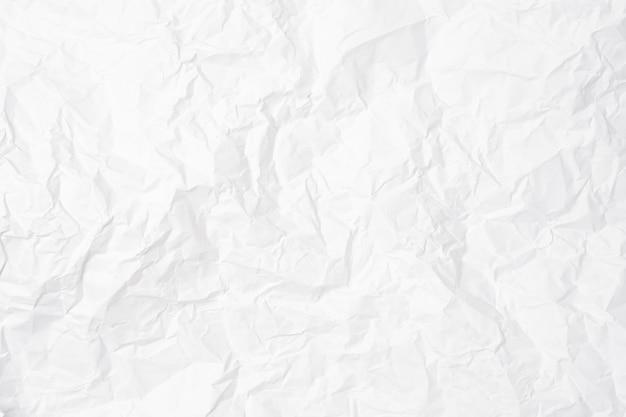 Gros plan du papier froissé blanc