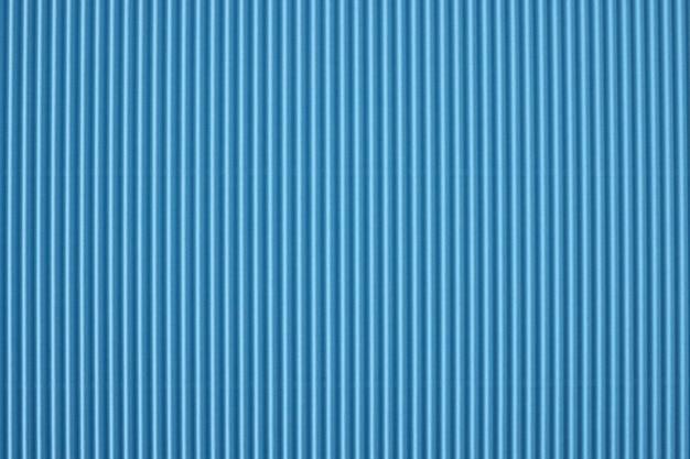 Gros plan du papier perforé à rayures bleues d'arrière-plan concept d'image