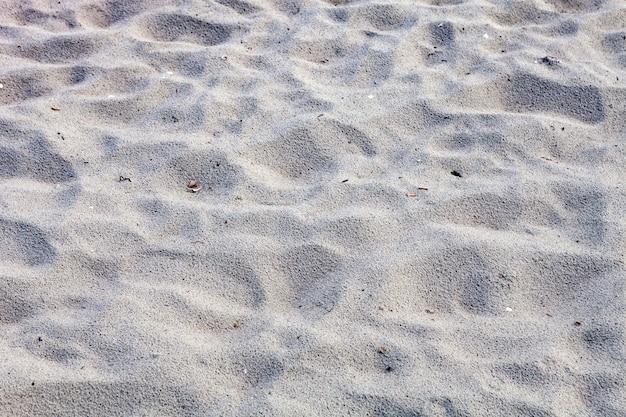 Gros plan du sable de la plage en été