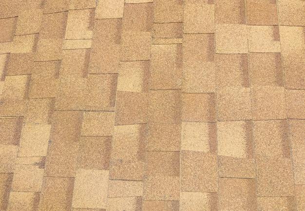 Gros plan du toit de bardeaux d'asphalte