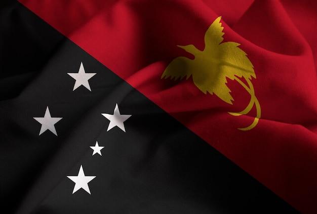 Gros plan, de, ébouriffé, papouasie-nouvelle-guinée, drapeau, papouasie-nouvelle-guinée, drapeau, souffler, dans, vent