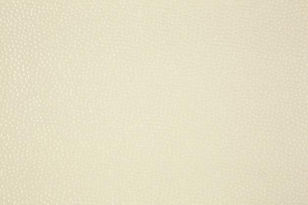 Gros plan de l'échantillon de cuir texturé artificiel beige