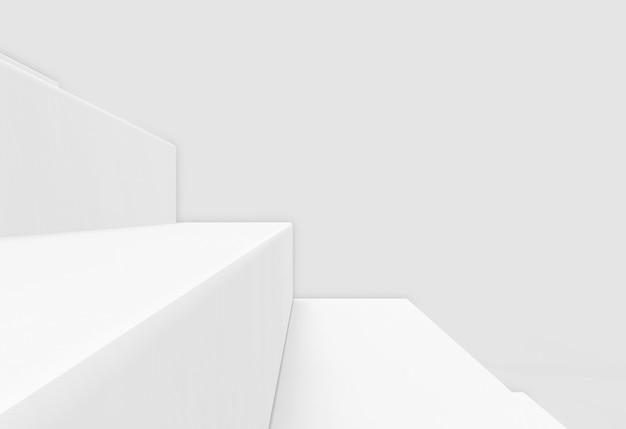 Gros plan sur un escalier blanc sur un mur gris comme toile de fond.