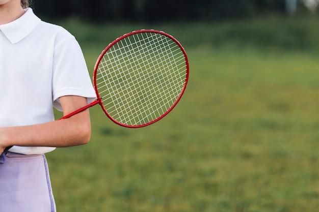 Gros plan, fille, tenue, badminton, dans parc