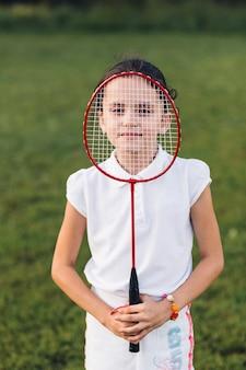 Gros plan, fille, tenue, badminton, visage
