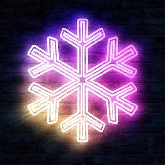 Gros plan sur flocon de neige néon brillant sur fond noir