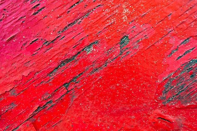 Gros plan d'un fond en bois patiné rouge