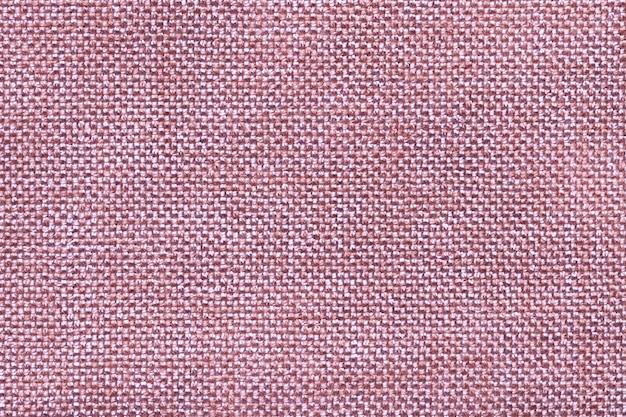 Gros plan de fond textile rose. structure de la macro de tissu