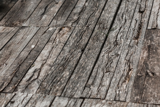 Gros plan de fond texturé en bois patiné