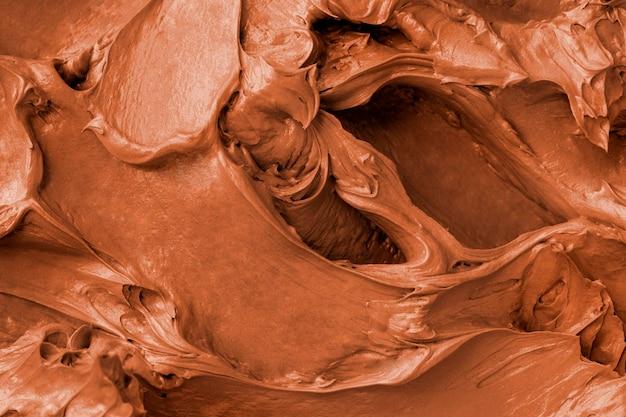Gros plan de fond de texture de glaçage brownie