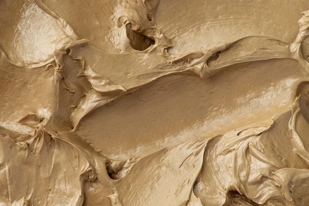 Gros plan de fond de texture de glaçage brun