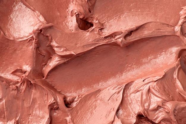 Gros plan de fond de texture de glaçage rose