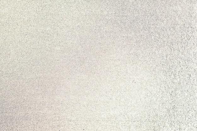 Gros plan de fond texturé jaune paillettes