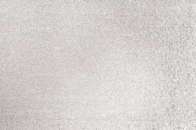 Gros plan d'un fond texturé de paillettes grises