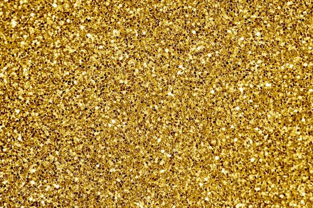 Gros plan de fond texturé de paillettes d'or