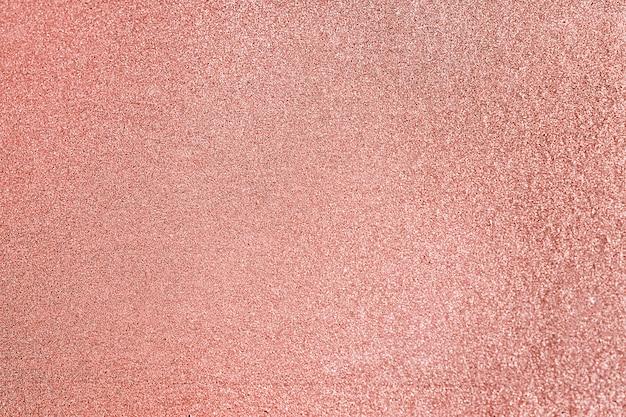 Gros plan sur fond texturé de paillettes rose blush