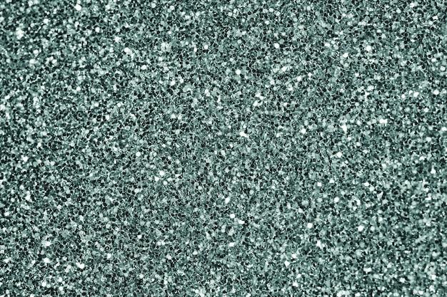 Gros plan de fond texturé de paillettes vert