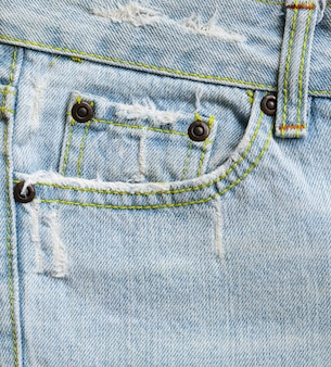 Gros plan de fond de texture de poche jeans denim bleu