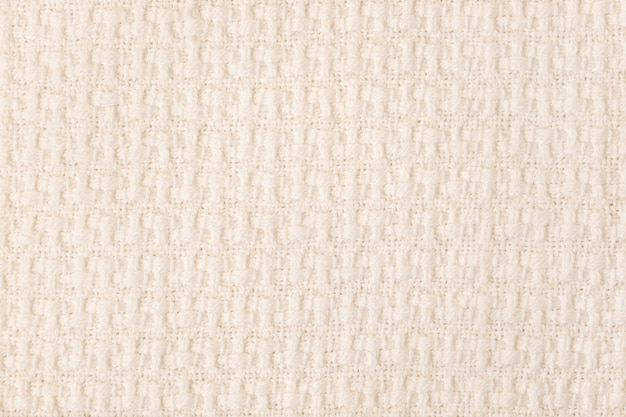 Gros plan de fond de texture de tissu tricoté beige