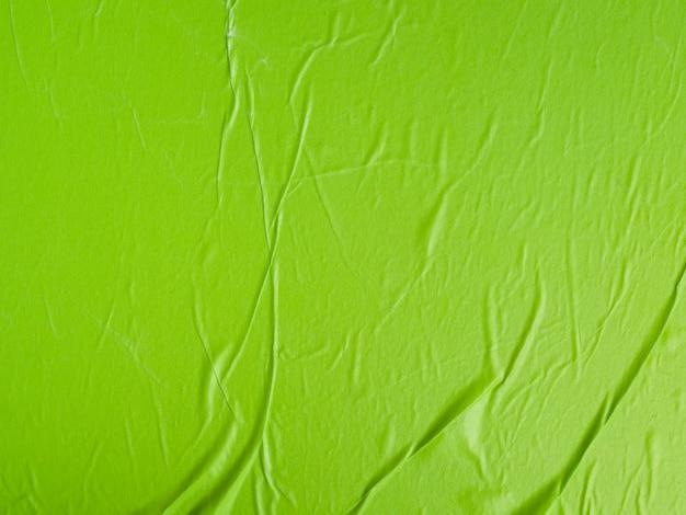 Gros plan fond texturé vert froissé