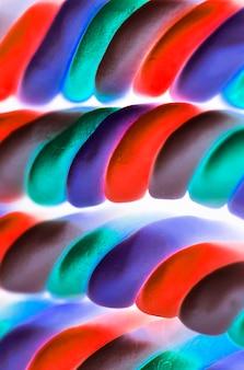 Gros plan d'un fond torsadé de guimauve dans un filtre négatif