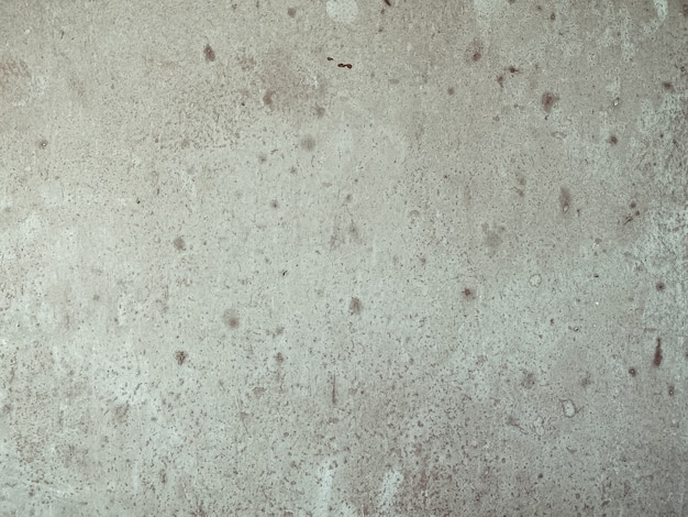 Gros plan horizontal sur le vieux mur de béton tacheté gris
