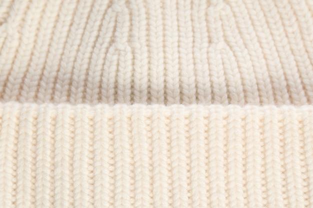 Gros plan de laine de texture blanche, tissu tissé, tissu tricoté