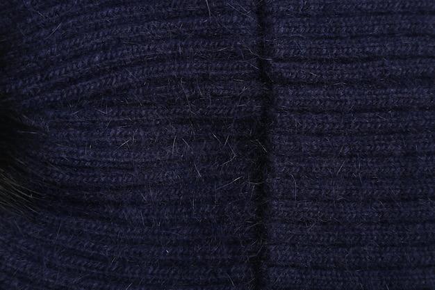Gros plan de laine de texture bleu foncé, tissu tissé, tissu tricoté