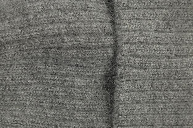 Gros plan de laine de texture grise, tissu tissé, tissu tricoté