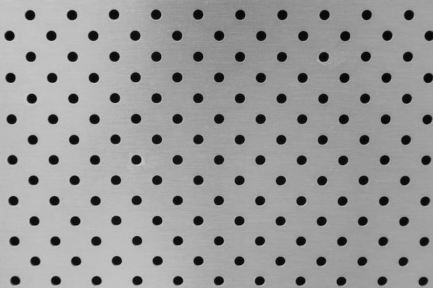 Gros plan, de, léger, métal, surface, de, lisse, mur, à, ouvertures rondes