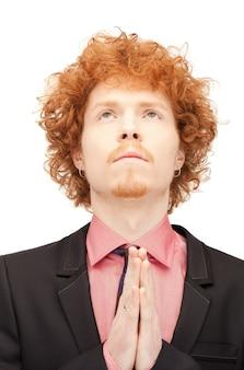 Gros plan lumineux portrait photo d'homme d'affaires en prière