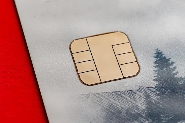 Gros plan macro détail doré de la carte de crédit bancaire