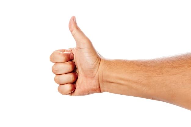 Gros plan de la main masculine sur un blanc montre un comme. isoler.