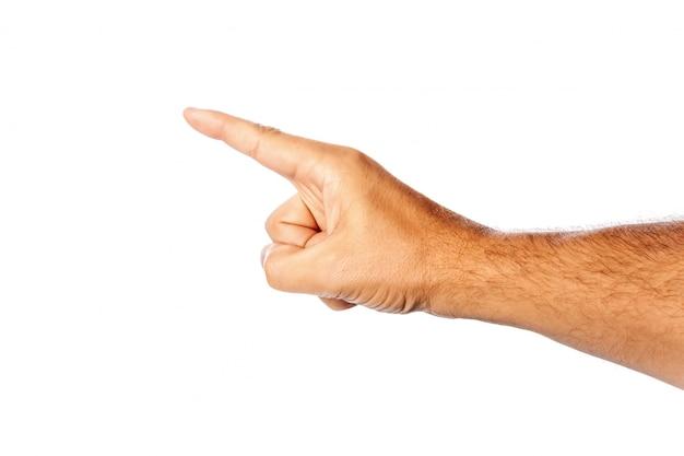 Gros plan d'une main masculine sur un blanc montre un index. isoler.