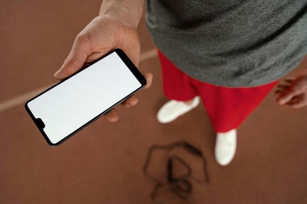 Gros plan, main, tenue, smartphone