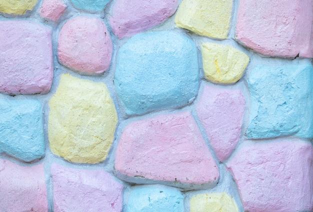 Gros plan motif de briques de surface au mur de briques colorées fond texturé