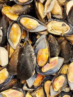 Gros plan de moules surgelées. texture des aliments. fruit de mer