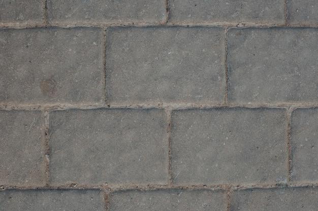 Gros plan de mur de bloc gris