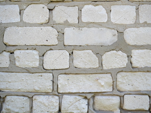 Gros plan d'un mur de blocs blancs