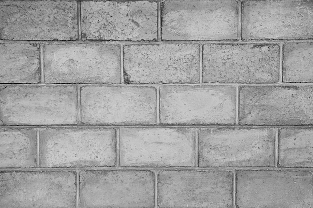 Gros plan de mur de brique grise