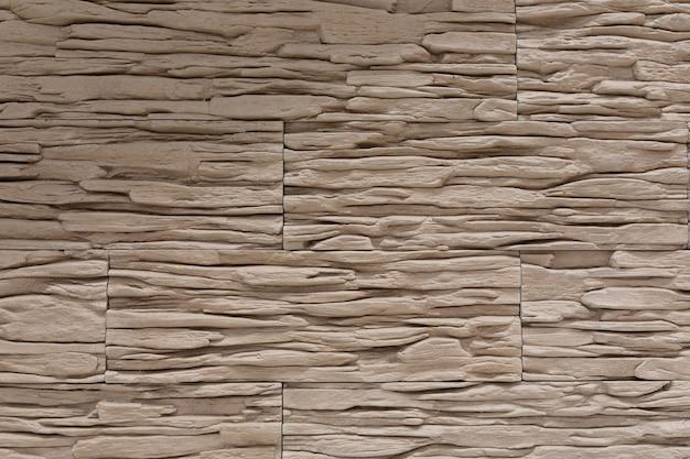 Gros plan de mur de plaques de plâtre brun.