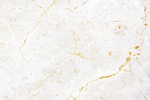 Gros plan d'un mur texturé en marbre blanc