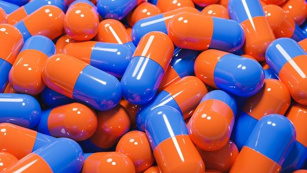 Gros plan de nombreuses capsules de pilules orange et bleu
