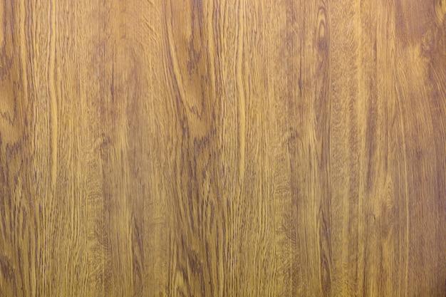 Gros plan de la nouvelle surface en bois naturel doux jaune brun doré, parquet, planches ou planches. texture écologique, sol ou mobilier. abstrait de l'espace de copie verticale.
