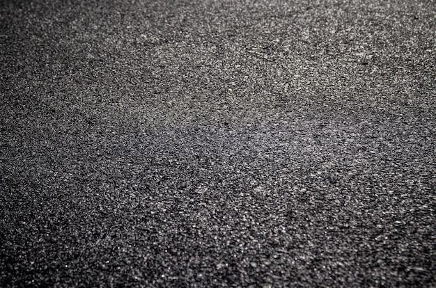 Gros plan sur la nouvelle texture de la route asphaltée peut être utilisé comme arrière-plan