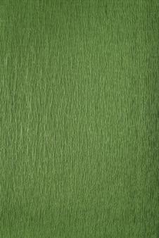 Gros plan de papier d'emballage vert. fond texturé vert. cadre vertical.